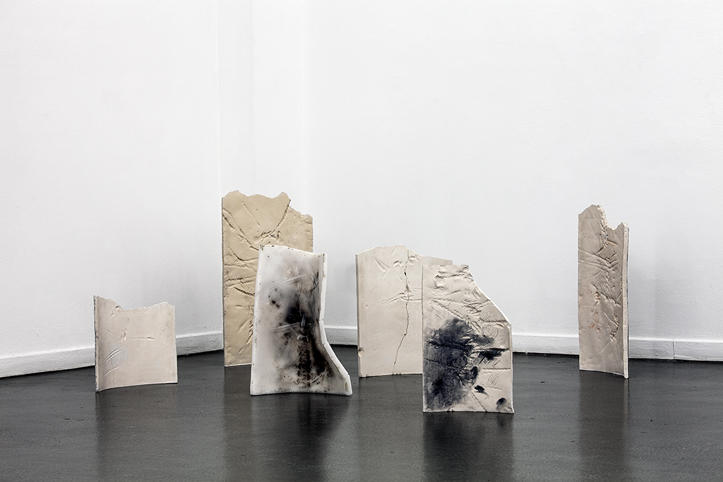 """Ruins"", installation view / burned clay, grafit, wax, dirt. Installation view INDEX 13, Hamburg Kunsthaus 2013 . Photo: Hayo Heye"